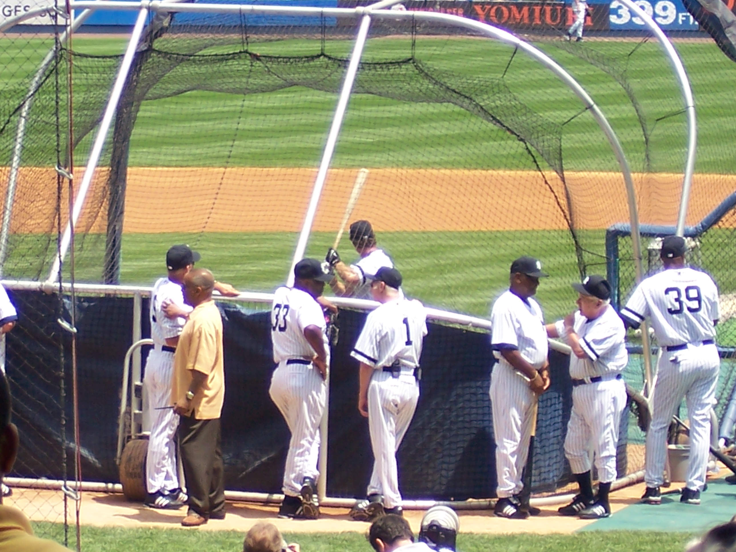 Griffey Sr., Bobby Murcer, and others around the batting cage OT Day.jpg