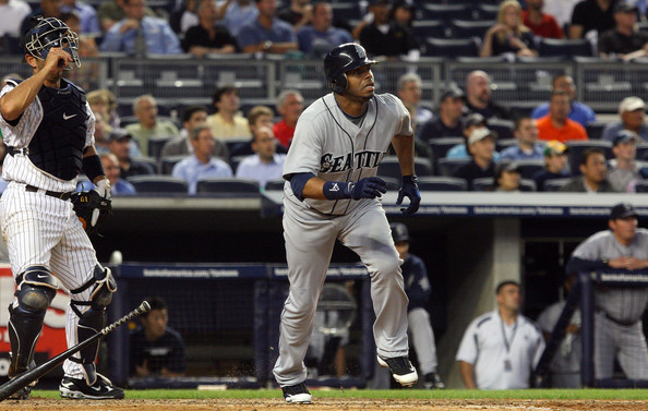 Griffey watches his home run sail out of the new Yankee Stadium on July 1
