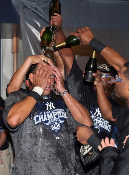Yankee players drench each other with champagne in celebration of their AL East Title