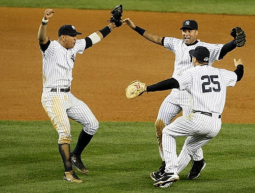 Alex Rodriguez, Mark Teixeira, and Derek Jeter come together after the clincher
