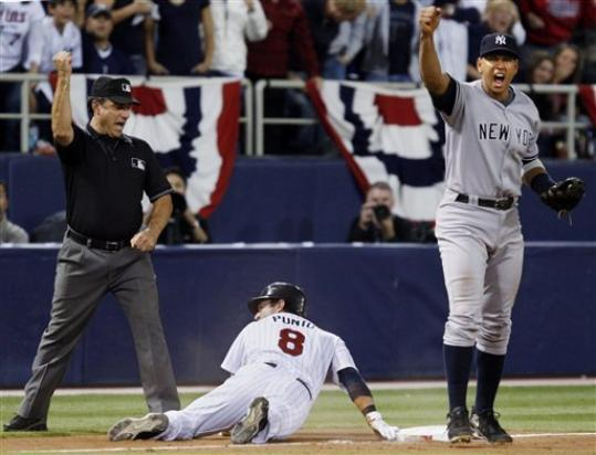 Nick Punto was nailed at third, thanks to a heads-up play by Derek Jeter
