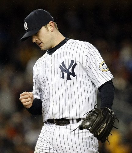 David Robertsin earned the win in relief, his second postseason victory