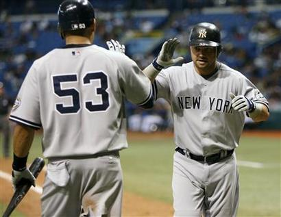 Nick Swisher and Melky Cabrera left 12 men on base in game three