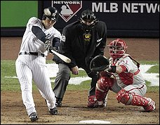 Hideki Matsui hits a home run in the second inning of game six