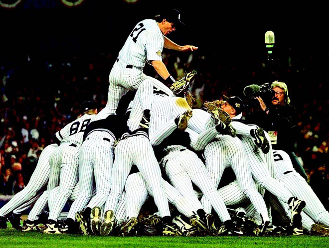 Paul O'Neill atop the dog pile of Yankees celebrating their 1996 title