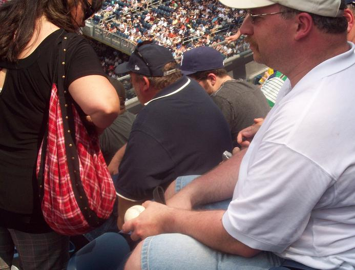 This guy with the foul ball that got away....
