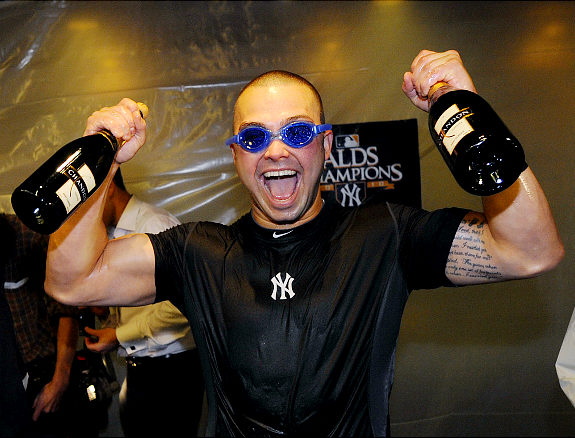 Nick Swisher celebrates the Division title