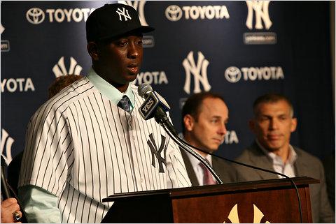 Cashman looks thrilled.