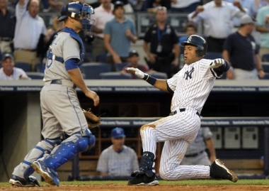 Jeter slides in to complete his inside-the-park home run on July 22